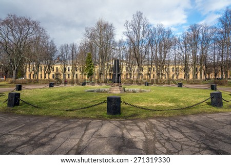 Park with old abandoned fountain, decorated with vintage cannons - stock photo
