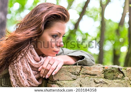 Park woman sadness autumn loneliness - stock photo