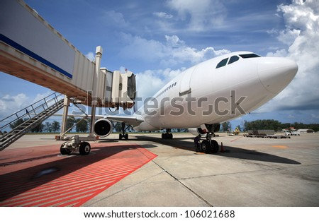Parked aircraft parked in the airport waiting for passengers - stock photo