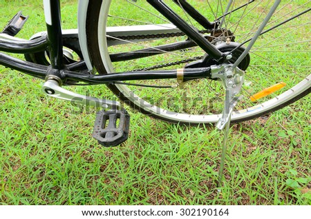 Parked bicycle using stand in the park