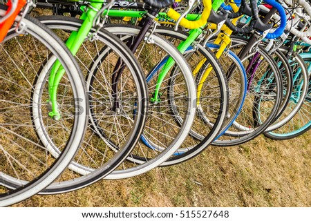 Parked bicycles on a bicycle parking in a row
