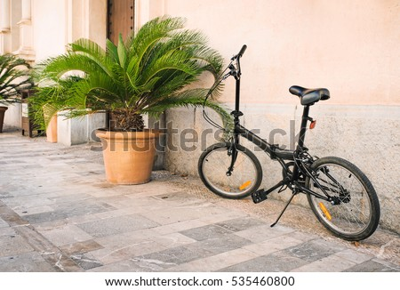 Parked bicycles on a streets in Palma de Mallorca, Balearic islands, Spain.