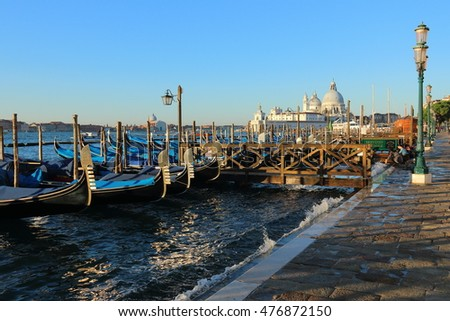 Parked gondolas at waterfront Venice Italy October 22, 2015