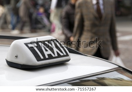 Parked taxi car roof detail, selective focus on taxi sign - stock photo