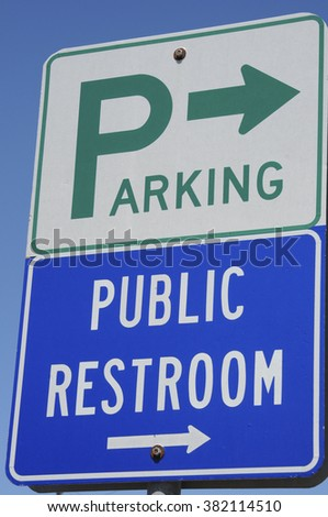 Parking and public restroom sign, Cambria, California, USA