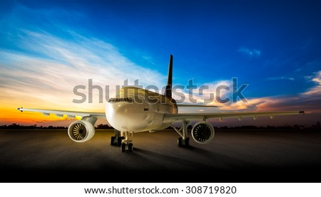 Parking business airplane at the airport runway in the beautiful sunset background - stock photo
