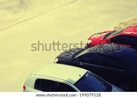 Parking cars and road, vintage background - stock photo