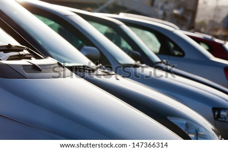 Parking cars in beautiful sunshine - stock photo