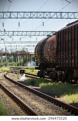 Parking cars on a railway line - stock photo