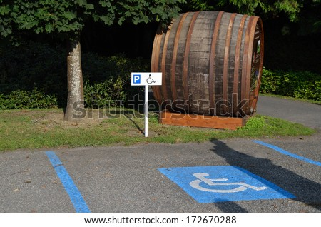parking for handicapped with large wine barrel