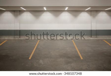 Parking garage department store interior with blank billboard - stock photo