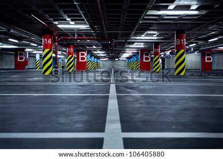 Parking garage underground, industrial interior.  Neon light in bright industrial building. - stock photo