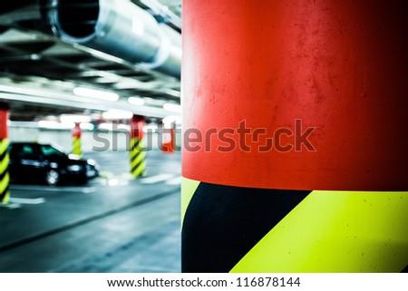 Parking garage underground interior. Bright neon light in industrial building basement, steel and concrete. - stock photo