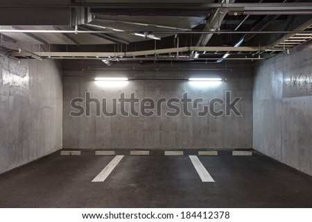 Parking garage underground interior, neon lights in dark  - stock photo