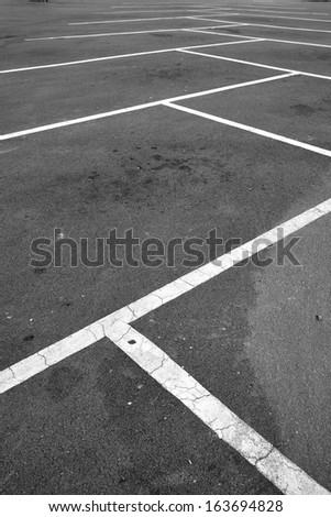 Parking hold separated by white lines. - stock photo