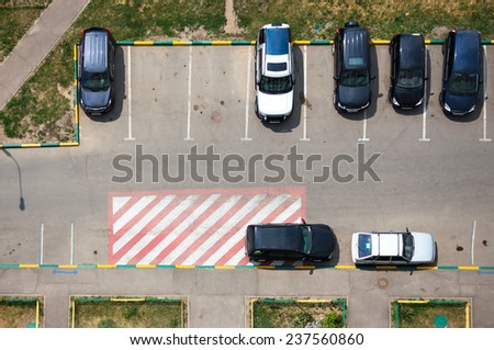 Parking in front of multi-storey building - stock photo