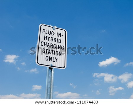 Parking lot sign for electric or hybrid car