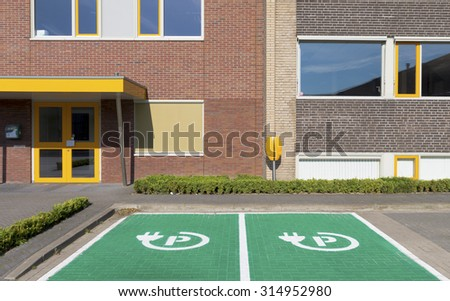 parking place and charging station for electric cars - stock photo