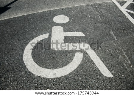 parking place for the disabled with sign - stock photo