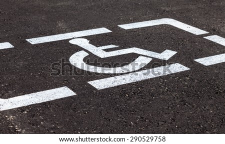 Parking places with handicapped or disabled signs and marking lines on asphalt - stock photo