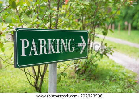 parking sign in a green park - stock photo