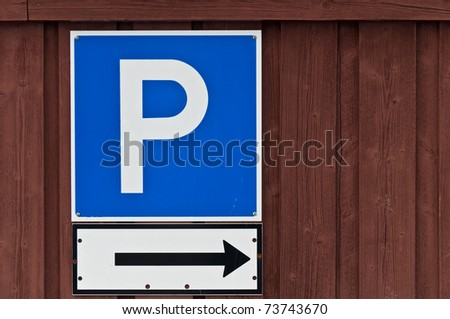 Parking sign on a brown wooden wall - stock photo