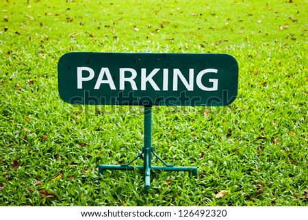 parking sign over green lawn - stock photo