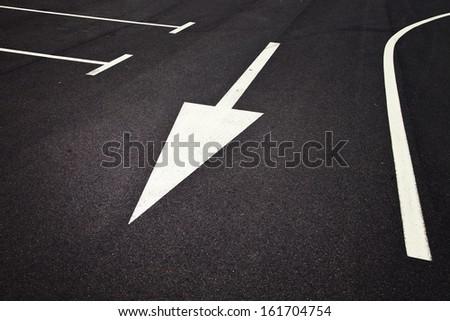 Parking sign symbols with arrow on asphalt. - stock photo