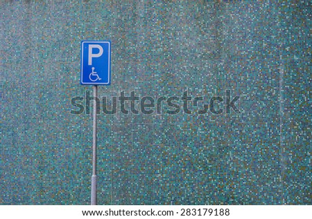 parking signs on blue background - stock photo