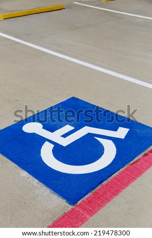 parking space with blue handicap icon painted inside - stock photo