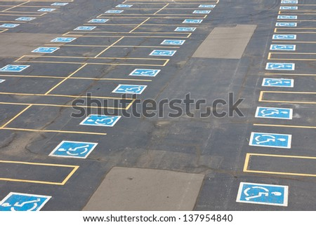 Parking spaces reserved for the handicapped in outdoor parking lot. - stock photo