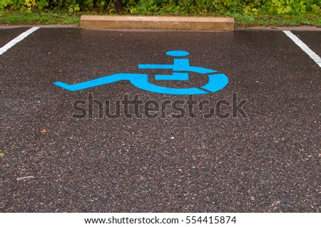 Parking spot for handicapped persons