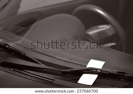 Parking ticket on car windscreen. transportation and vehicle concept - stock photo