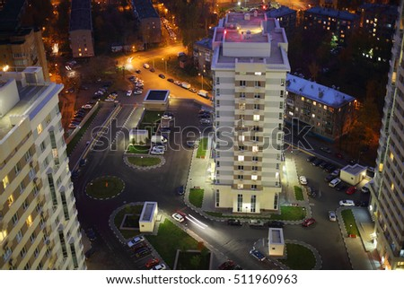 Parking, yard on stylobate in residential complex at summer evening, top view