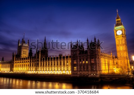 Parliament at dusk reflecting light on the River Thames, London, November