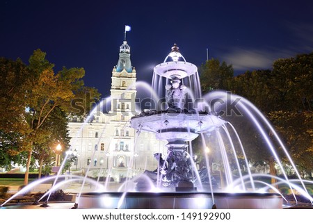 Parliament Building and fountain at night in Quebec City - stock photo