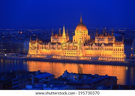 Parliament building reflected by the Danube river by night, Budapest, Hungary