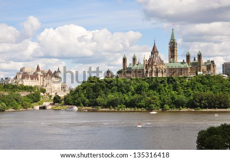 Parliament Buildings and Fairmont Chateau Laurier Hotel in Ottawa, Ontario, Canada - stock photo