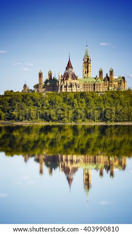 Parliament Buildings and Fairmont Chateau Laurier Hotel in Ottawa .View of Parliament Hill and Ottawa River - stock photo