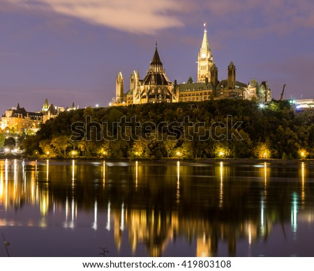 Parliament Hill in Ottawa at night from across the Ottawa River - stock photo
