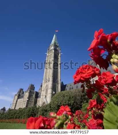 Parliament of Canada with red flowers in the foreground - stock photo