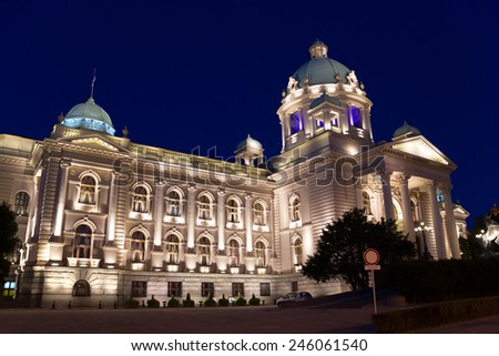 Parliament of Serbia palace, also known as National Assembly of the Republic of Serbia, night scene, illuminated by decorative light. It is situated in the centre of Belgrade on Nikola Pasic Square. - stock photo