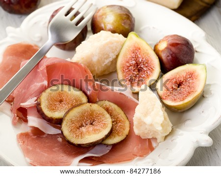 parma ham, parmesan cheese  and figs - stock photo