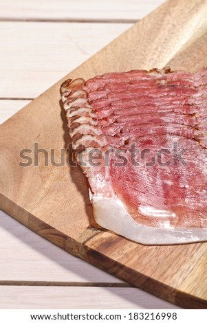 parma ham  sliced on a wooden board
