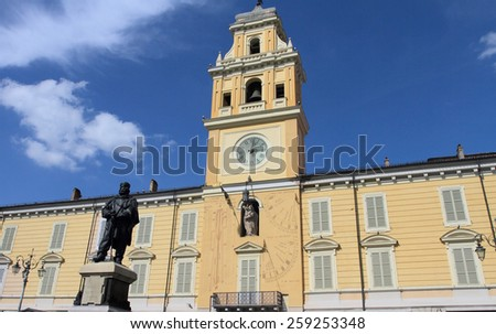 PARMA, ITALY - APRIL 1, 2014: Historic clock tower of Parma on April 1, 2014 in Parma, Italy. Parma is a popular unesco world heritage city in the province of Emilia-Romagna. - stock photo