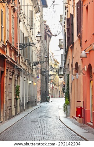 PARMA, ITALY - DECEMBER 25, 2014: Narrow old street in the city of Parma, Italy. Colorful bright buildings.