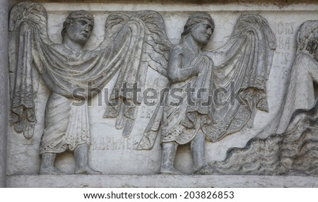 PARMA, ITALY - MAY 01, 2014: Archangels Raphael and Gabriel by Benedetto Antelami. Baptistery in Parma is considered to be among the most important Medieval monuments in Europe.