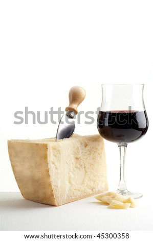 parmesan cheese and wine glass - stock photo