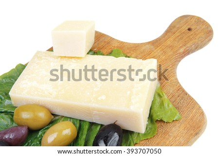 parmesan cheese on wooden platter with olives and tomato isolated over white background