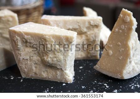 parmesan cheese seasoned for sale at Borough Market - stock photo